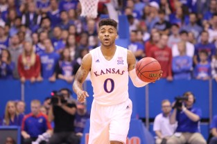 Guard Frank Mason, a senior from Petersburg, Virginia, dribbles the basketball up the court during the game on Nov. 25. Kansas beat UNC Asheville 95-57 at Allen Fieldhouse. Ashley Hocking/KANSAN