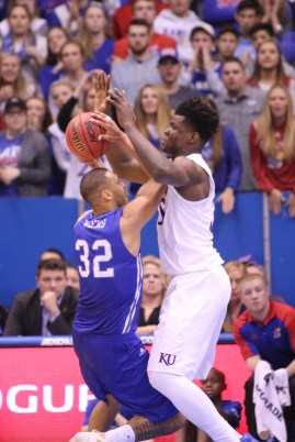 Center Udoka Azubuike, a freshman from Delta, Nigeria, blocks UNC Asheville player Will Weeks during the game on Nov. 25. Azubuike netted a career-high of 17 points. Kansas won 95-57 at Allen Fieldhouse. Ashley Hocking/KANSAN