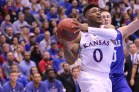 Guard Frank Mason, a senior from Petersburg, Virginia, prepares to shoot a basket during the basketball game against UNC Asheville on Nov. 25. The Jayhawks won 95-57 at Allen Fieldhouse. Ashley Hocking/KANSAN