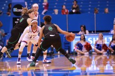 Guard Aisia Robertson, a sophomore from San Francisco, Calif., plays defense during the first half of the women's basketball game on Nov. 27. Kansas beat North Dakota 76-71 in overtime. Ashley Hocking/KANSAN