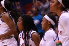Guard Jayde Christopher, a sophomore from Federal Way, Wash., cheers for her teammates from the sidelines when the Jayhawks win the women's basketball game on Nov. 27. Kansas beat North Dakota 76-71 in overtime. Ashley Hocking/KANSAN