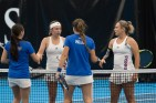 Sophomores Anastasia Rychagova and Janet Koch shake hands with Saint Louis' Aspen Cervin and Mariluz Rojo Domingo after defeating them 6-1 at Jayhawk Tennis Center on Jan. 20. Rychagova is from Moscow, Russia and Koch is from Durbanville, South Africa. Ashley Hocking/KANSAN