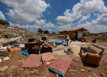 Palestinans inspect the remains of her demolished house, on August 11, 2020, near Jenin in the northern West Bank village of Farasin, where Israel insists it must approve any new residential construction and can tear down homes built without permits. Photo by Shadi Jarar'ah