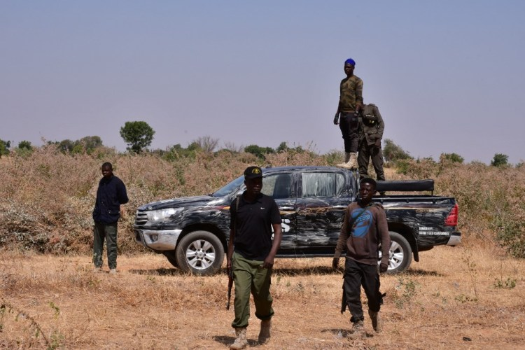 Nigerian security forces are seen on the site of a sabotage attack allegedly perpetrated by Boko Haram against electical infrastructures on the outskirts of Maiduguri on February 12, 2021. (Photo by Audu MARTE / AFP)