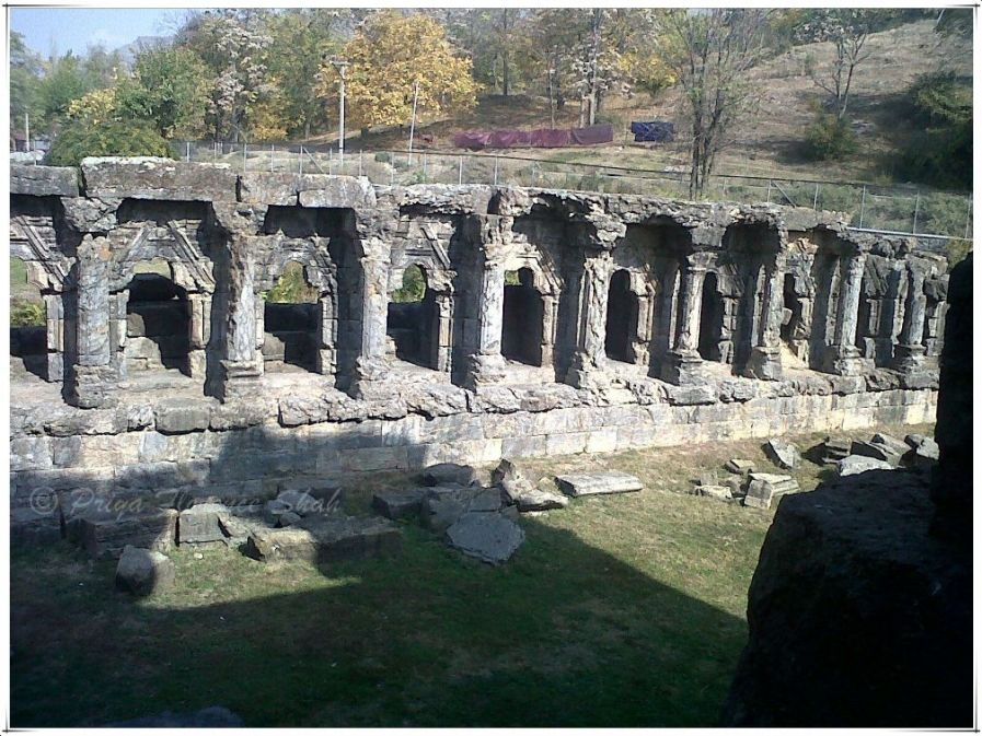 Greek style pillars line the smaller shrines surrounding the courtyard