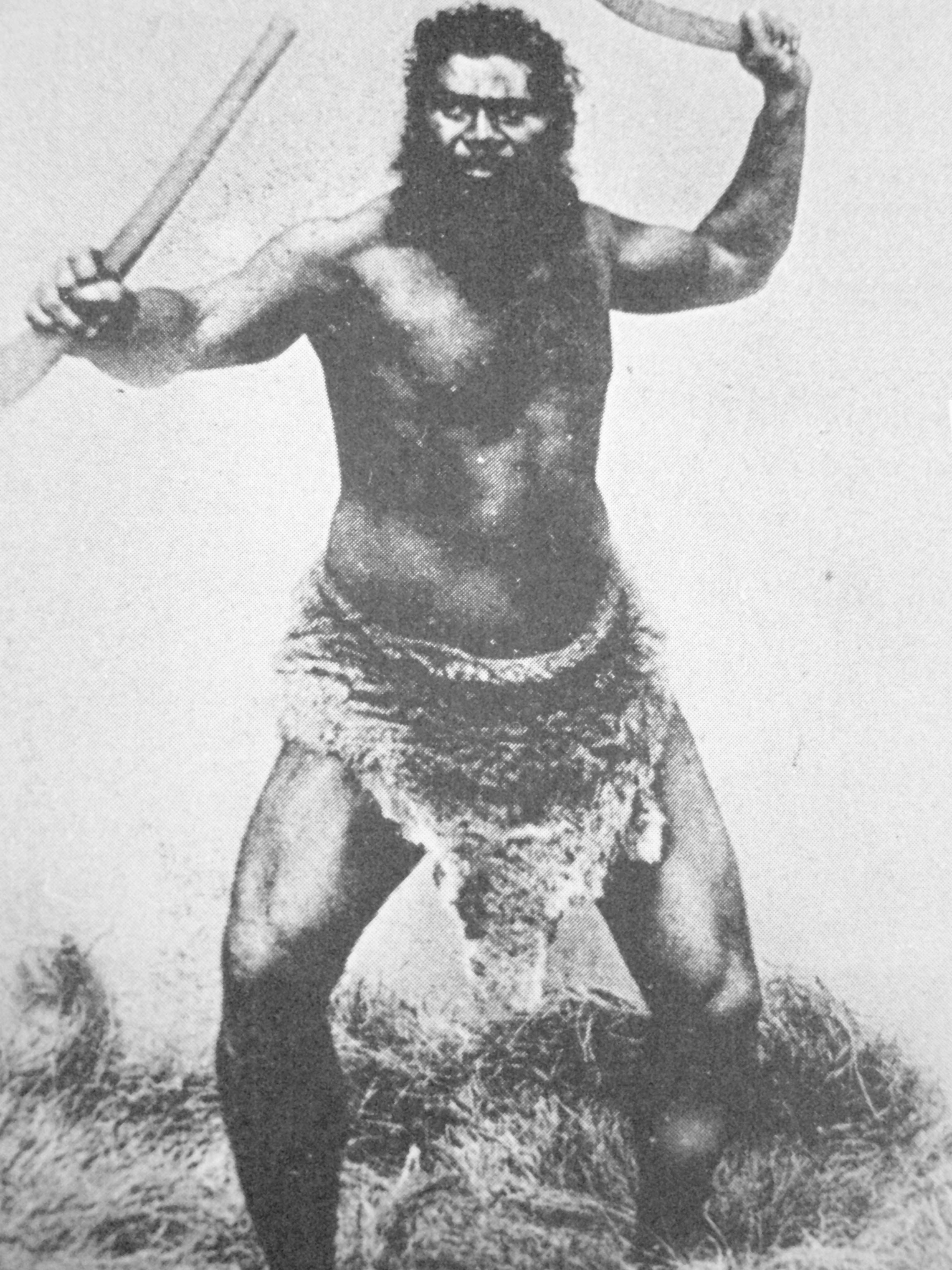 Guerrier aborigène lançant un boomerang.