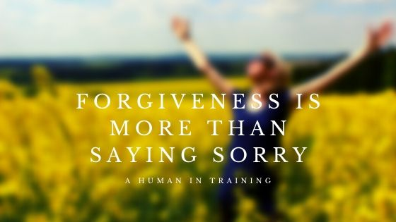 Woman in field saying that Forgiveness Is More Than Saying Sorry