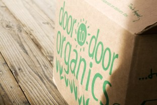 I flip the eggs around and while they're finishing, I put the Door-to-Door Organics box out.