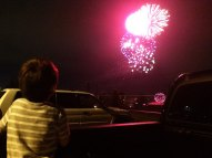 B watching fireworks in the back fo dada's truck on the 4th of July