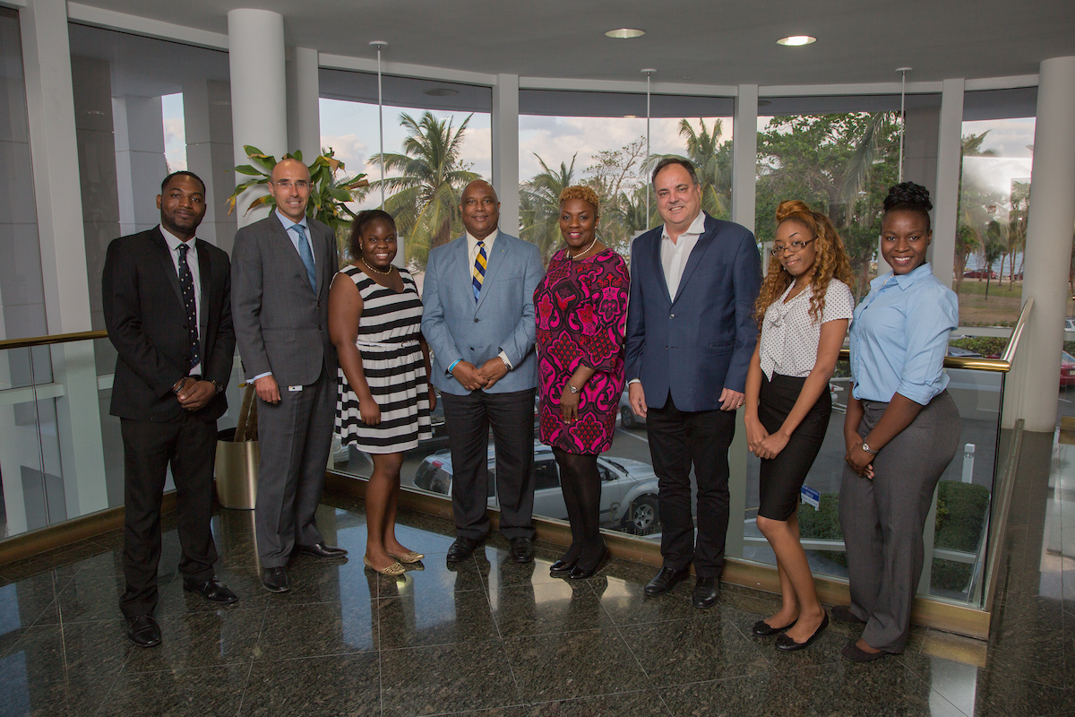 Shown with four of the students are AIBT director Bernard Sechaud (2nd from left), current AIBT Co-Chair Bruno Roberts (4th from left), Past Chair Antoinette Russell (5th from left) and AIBT Treasurer Jean-Marc Fellay (3rd from right).