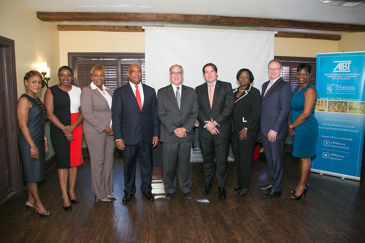 Left to right: Latonya Tinker, Ministry of Financial Services, Christina Rolle, Executive Director, Securities Commission of The Bahamas, Antoinette Russell, AIBT Director, Bruno Roberts, AIBT Co-Chair, Hon. Brent Symonette, Minister of Financial Services, Trade and Industry and Immigration, Ivan Hooper, AIBT Co-Chair, Tanya McCartney, Bahamas Financial Services, CEO & Executive Director, Jan Mezulanik, AIBT Deputy Chair, and Tanya Murray, Ministry of Financial Services.