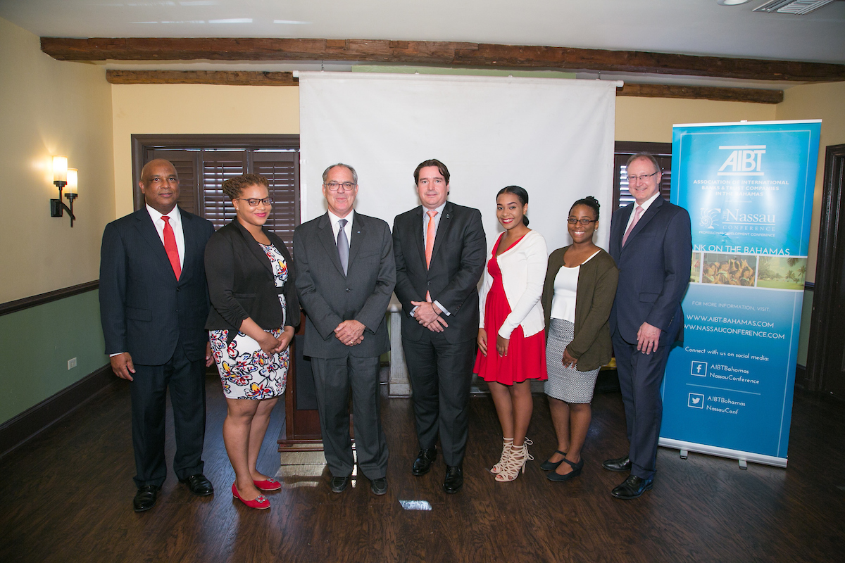 Left to right: Bruno Roberts, AIBT Co-Chair, Kethera Thompson, AIBT Student Intern, Hon. Brent Symonette, Minister of Financial Services, Trade and Industry and Immigration, Ivan Hooper, AIBT Co-Chair, Noelicia Turnquest, AIBT Student Intern, Jewelle Paul, AIBT Student Intern, Jan Mezulanik, AIBT Deputy Chair.