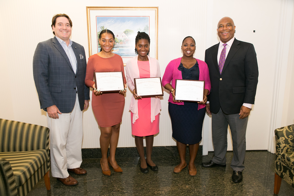 From L-R: Ivan Hooper, AIBT Co-Chairman; Noelicia E. Turnquest, Spanish Immersion Student; Sherelle Fernander, Spanish Immersion Student; Indira Smith, Summer Internship Student (Winterbotham Trust); Bruno Roberts, AIBT Co-Chairman