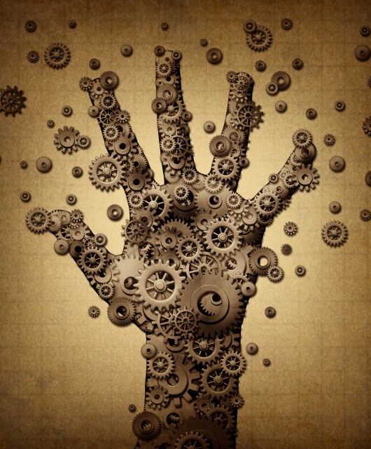Technology touch concept and robotics or robot symbol as a group of mechanical gears and gog machine wheels shaped as a human hand as a metaphor for bionic engineering or artificial intelligence spread.