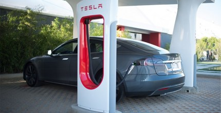 A Tesla supercharger in action. The UK is experiencing a significant shortage in these vital charging points.