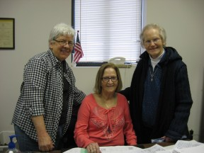 Sr. Carol pays a visit to the Ladies of Charity office, and visits with, left to right, Jane Haas, President, and Judy Akers, Treasurer.