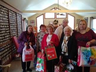 Members of St Mary's Ladies of Charity with some of the gifts they brought
