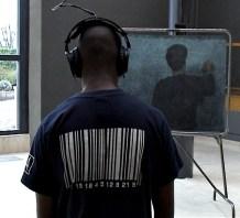 Tu me copieras l'histoire de France Jean-François Boclé Installation vidéo et sonore DVD, tableau d'école noir, craie blanche, casque audio, enceintes-2004- dimensions variables