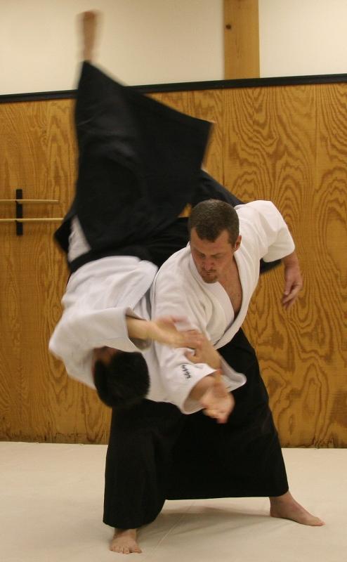Sensei Roberts performing Koshinage (hip throw)