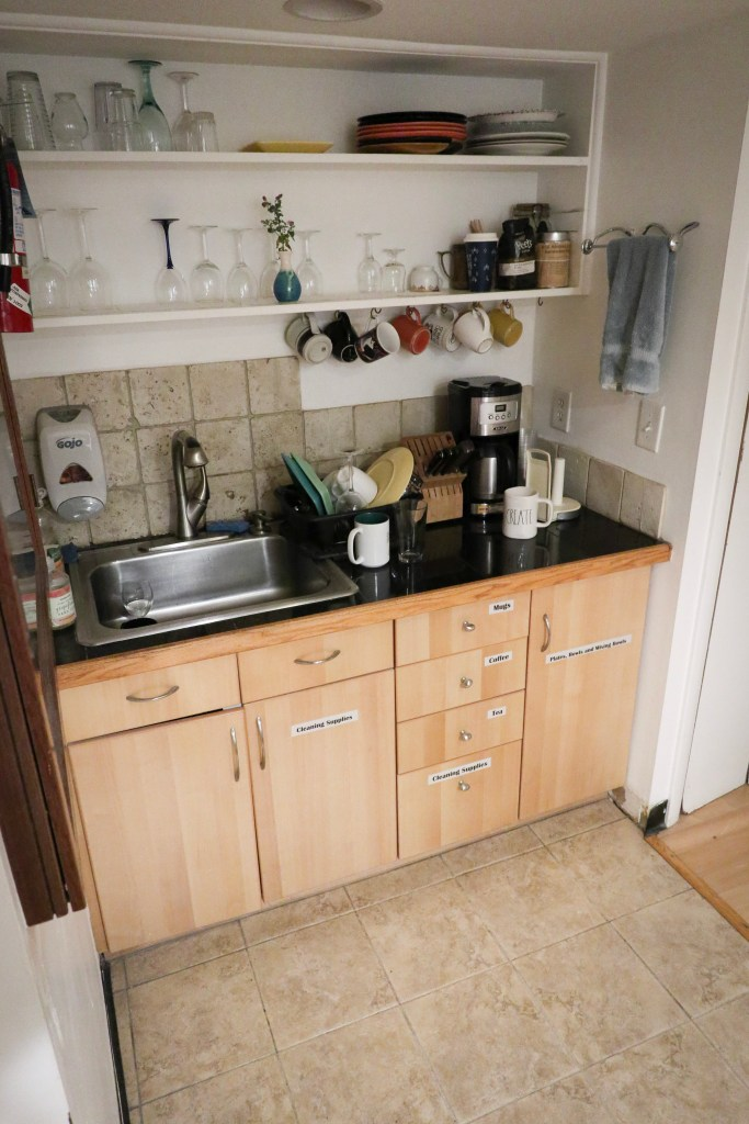 Kitchenette Sink, Dishes, and Coffee Maker