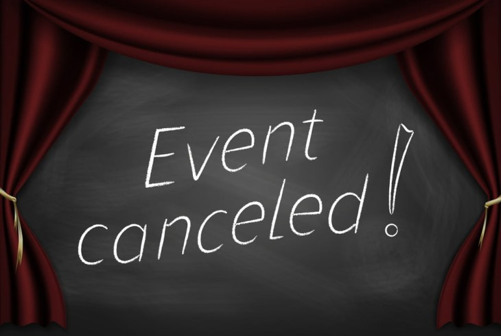 Event Cancelled written on a chalkboard surrounded by a banner