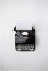 black typewriter on a white table