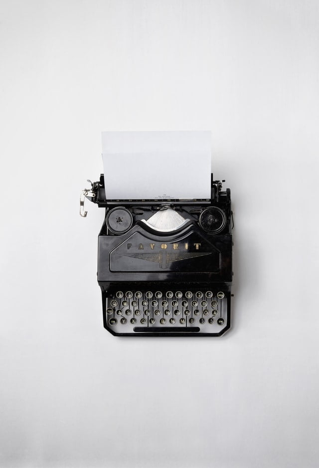 black typewriter on a white table