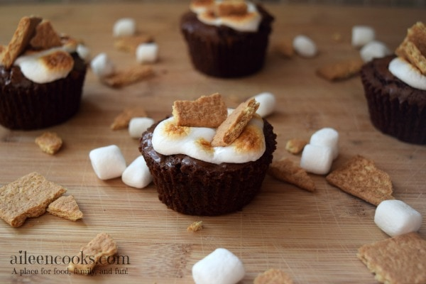 S'mores Brownie Cups made with brownies in a muffin tin and topped with  mini marshmallows and graham crackers. Enjoy summer any time!