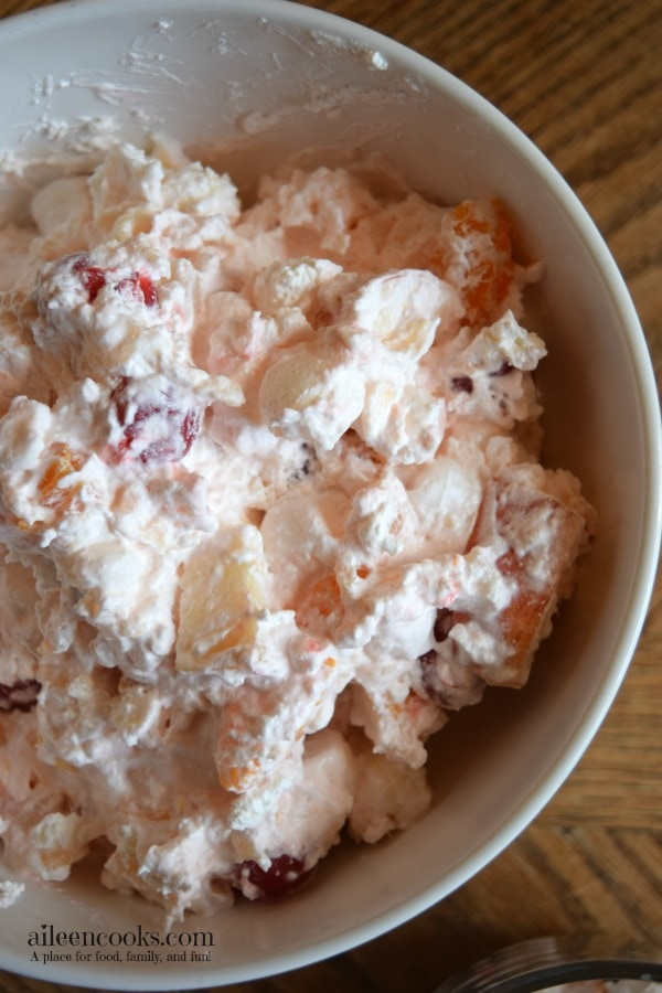 This creamy fruit salad is the perfect side dish for thanksgiving dinner or a backyard barbecue. It's perfectly sweet and could even pass as a healthy dessert. Recipe from aileencooks.com.