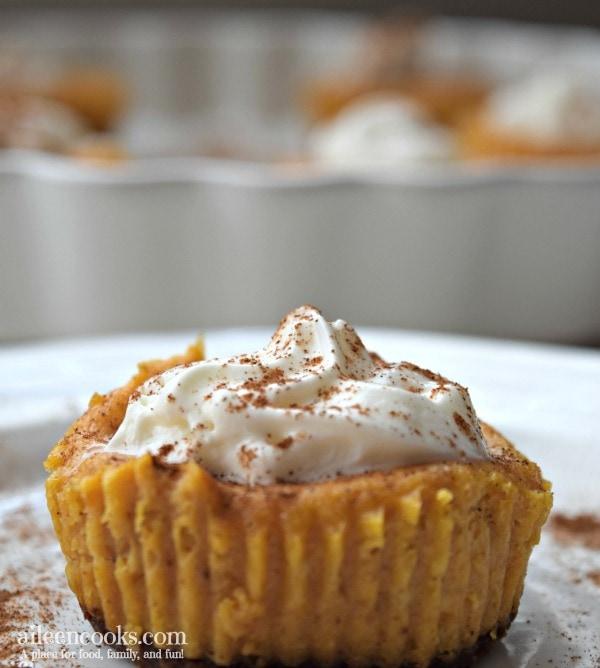 Mini Pumpkin Cheescakes - they are cheescakes in cupcake form! The perfect fall dessert.