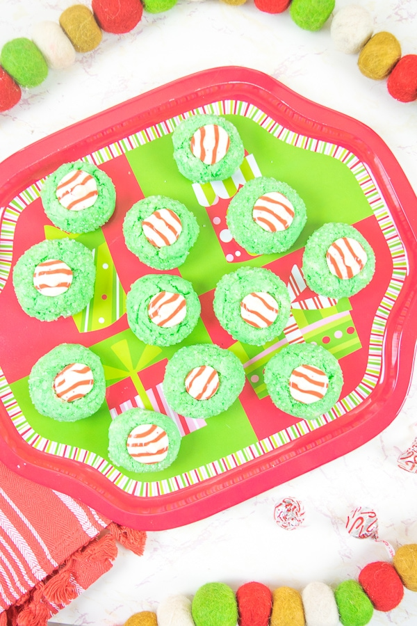 A christmas platter filled with grinch christmas cookies.