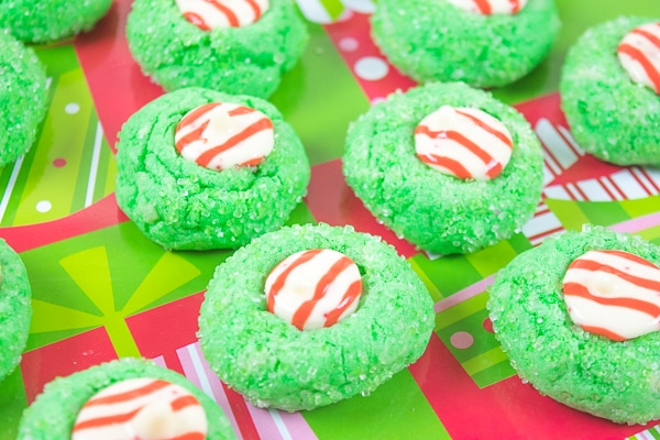 A close up of three grinch blossom christmas cookies.