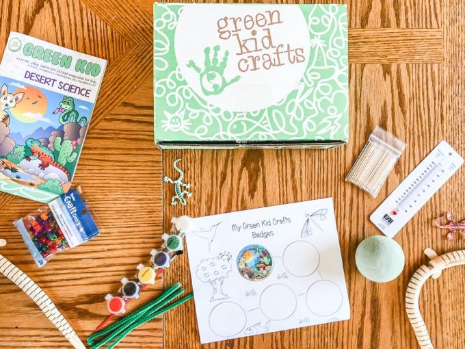 A flat lay of the green kid crafts subscription box and its contents.