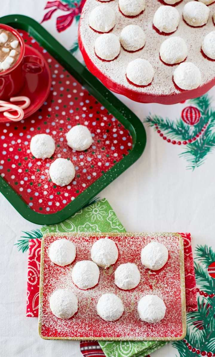 Mexican wedding cookies on festive Christmas background.