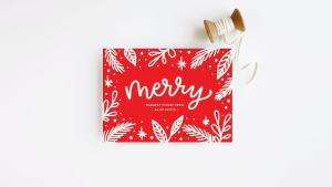 "Red holiday card with the word ""merry""."