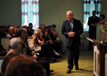 Former President Jimmy Carter greets members and visitors to Maranatha Baptist church in Plains, Georgia.
