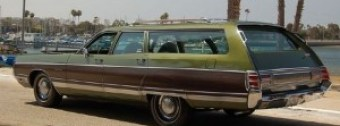 Our Chrysler was just like this one: green with faux wood panels. They just don't make them like this any more. (Thanks be to God.)