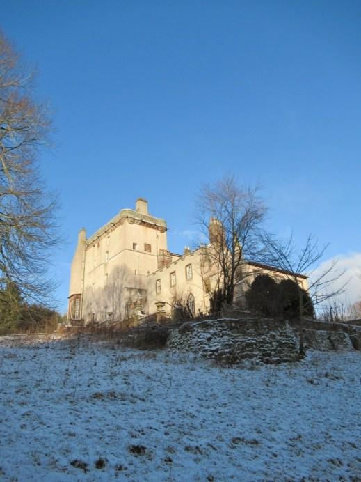 Delgatie Castle lit up in the sun. Ailish Sinclair | Castles in the Snow