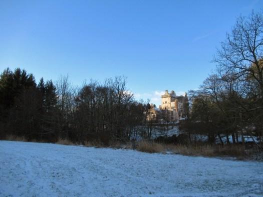 Delgatie Castle on the horizon. Ailish Sinclair | Castles in the Snow
