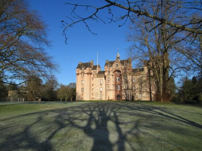 Shadows reach towards the castle.Ailish Sinclair | Castles in the Snow