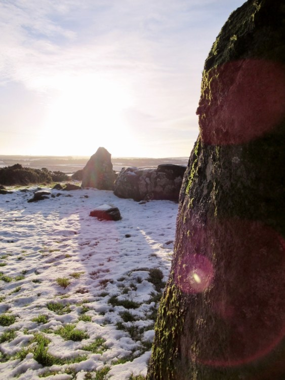 Sunshine and snow at Aikey Brae stone circle. Ailish Sinclair | Writer