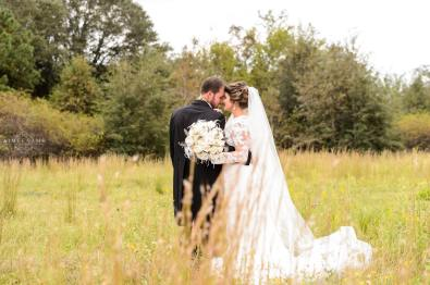 Wedding Couple stands in field