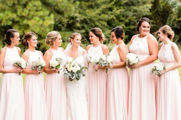 Bride and bridesmaids in blush dresses