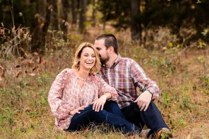 middle Georgia engagement session couple in field laughing