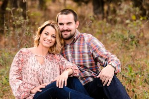 middle georgia engagement photographer session couple in field sunset pictures