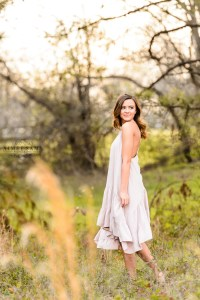 middle georgia senior portrait session, brown haired girl standing in field at sunset