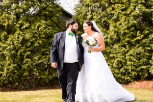 middle georgia wedding, bride and groom walking holding hands in garden