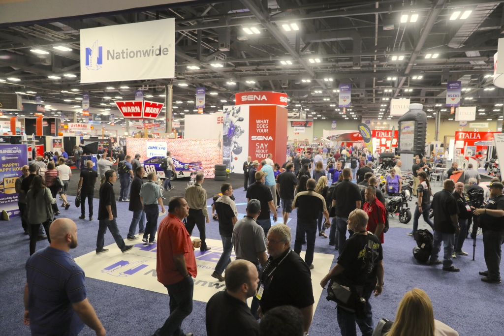 Dealers and consumers fill the entry to AIMExpo