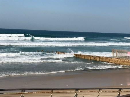 Beach Walk with surfers