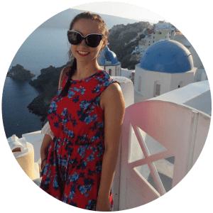 Profile picture in Santorini. Blue domes in the background.